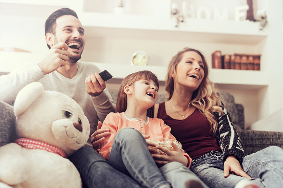 Personal Insurance - Family Enjoying Time Together at Home on the Couch